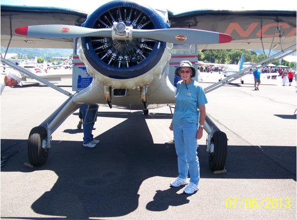 Director Dorothy Austin in front of the Stinson at the Roseburg Wings & Wheels event.
